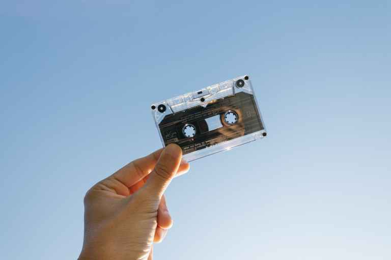 person holding cassette