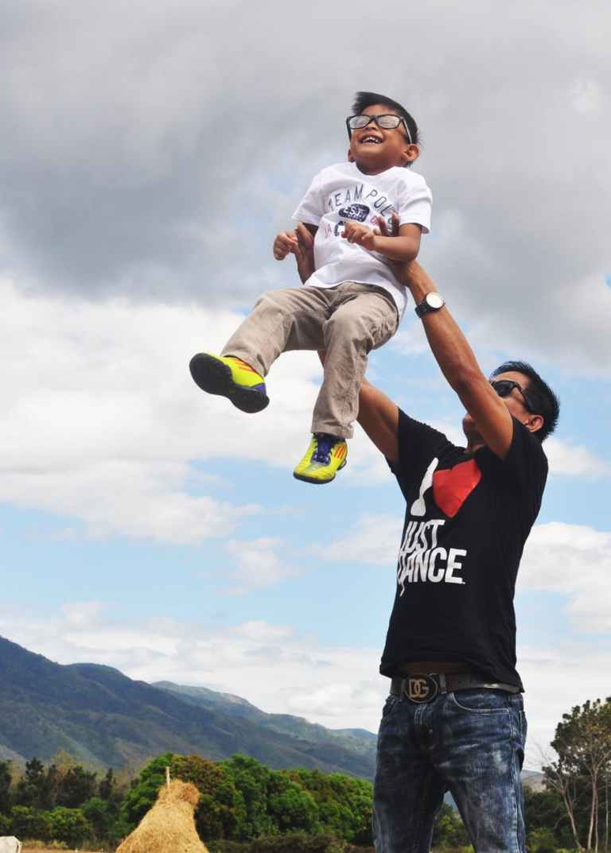 man carrying boy