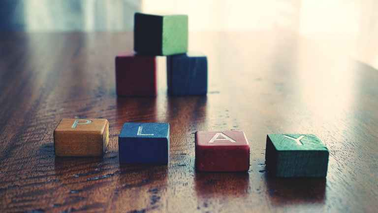 depth of field photograph of block toys