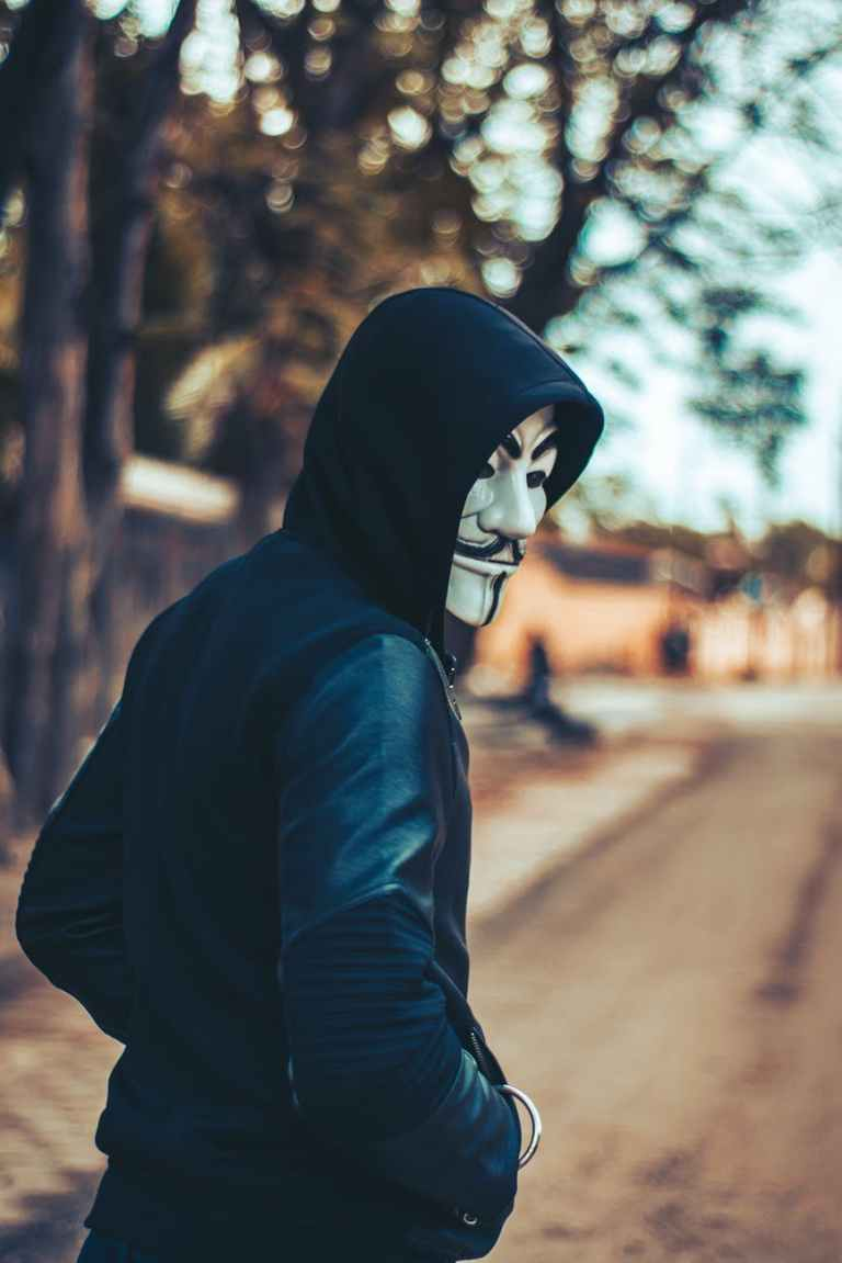 man wearing hoodie and mask