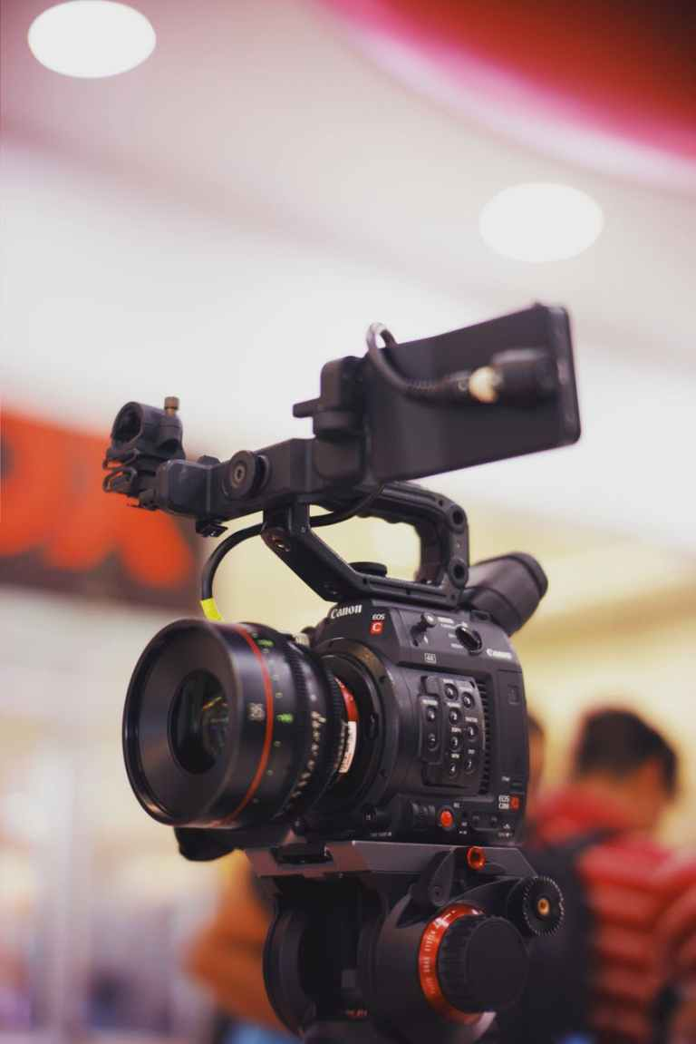 selective focus photography of professional video camera